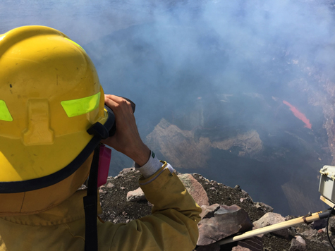 A USGS geologist uses a laser rangefinder to measure the depth of the lava lake at the summit of Hawaii's Kilauea volcano.