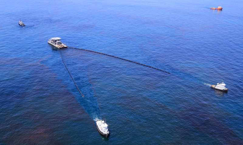 Boats skim oil from the Deepwater Horizon spill in May 2010.