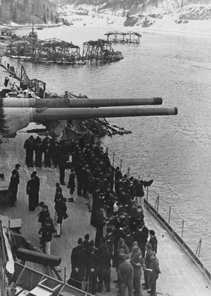 Crewmen of German warship Tirpitz gathered beneath barrels of 380-millimeter gun turret.