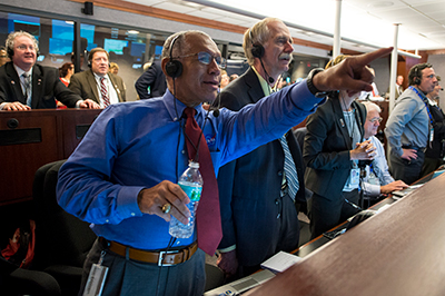 Bolden and others watch the Orion spacecraft splash down in the Pacific Ocean after an unmanned test flight in 2014.