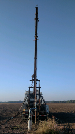 Recording fluid pressure at the bottom of the deep hole of an industrial wastewater injection well in Kansas.