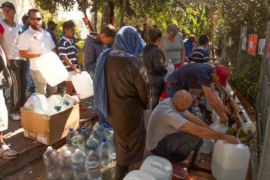 people wait for water at Newlands spring