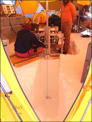 Researchers drilling an ice core at Mount Hunter