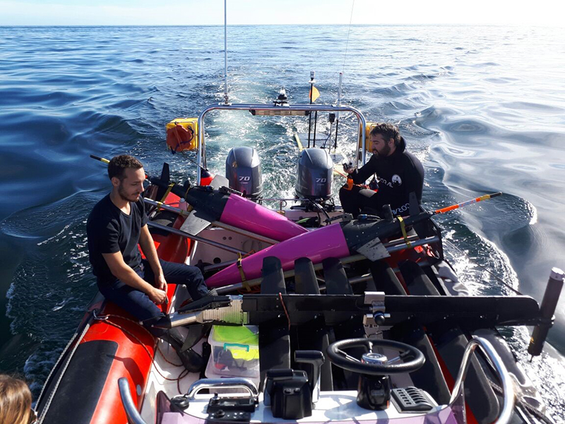 Researchers head out to sea to test two Seagliders (purple) off the coast of Cape Town prior to the GINA deployment.