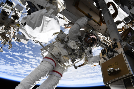 During a 16 May spacewalk, Drew Feustel installs and replaces equipment on ISS's truss.