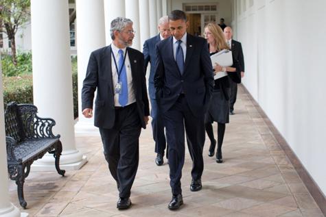 John Holdren walks along the White House colonnade with President Barack Obama in November 2010.