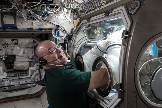 NASA astronaut Scott Tingle performs research inside the International Space Station earlier this year.