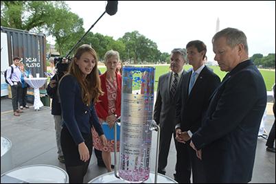 Julia Schnetzer, the scientific coordinator of the Ocean Plastics Lab, provides a tour of the exhibit to dignitaries.