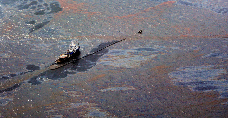 Oil on the surface of the Gulf of Mexico around a work boat at the site of the Deepwater Horizon oil spill in the Gulf of Mexico on 2 June 2010.