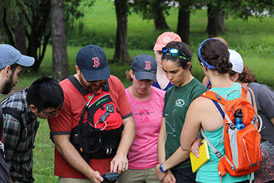 Testing water quality in Fayetteville Green Lake during a domestic field course on water and energy.