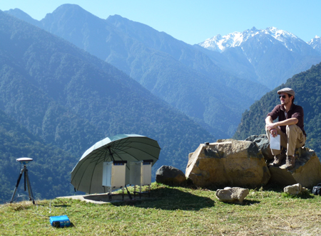 Research team member Théo Berthet monitors data collection during a campaign to a less-visited region in central Bhutan.