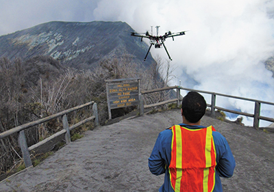 A drone pilot flies scientific instruments into the gas plume of Turrialba volcano