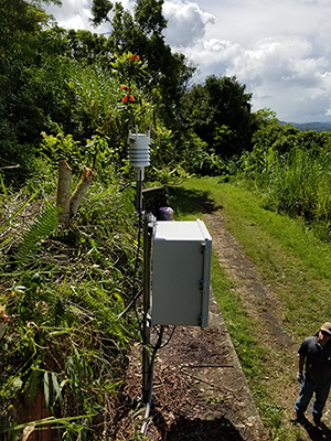 Installation of an infrasound sensor at GSN station IU-SJG in Puerto Rico.