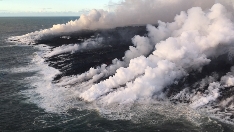 Lava from Hawaii's Kilauea volcano continues to enter the ocean near Kapoho, adding more new land to the shoreline.
