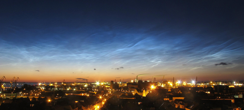 Noctilucent clouds over the city of Wismar, Germany, in July 2015.