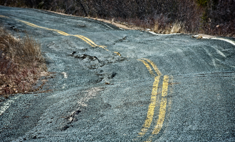 Repeated freezing and thawing of subsurface permafrost has buckled this road in Canada's Northwest Territories.