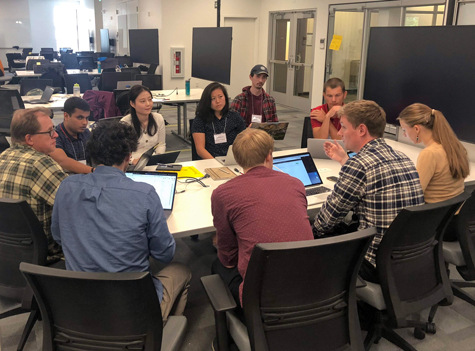 Participants discuss possible projects at 2018 Geohackweek.