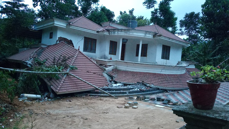 A house knocked off its foundation by a landslide in Mavadi, India.