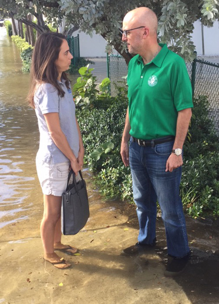 Rep. Ted Deutch speaks with a constituent during king tide flooding in Fort Lauderdale, Fla., on 17 October 2016.