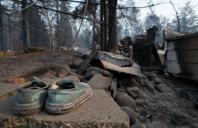 A child's shoes are seen outside the ruins of a home that burned in Paradise, California, in November 2018.