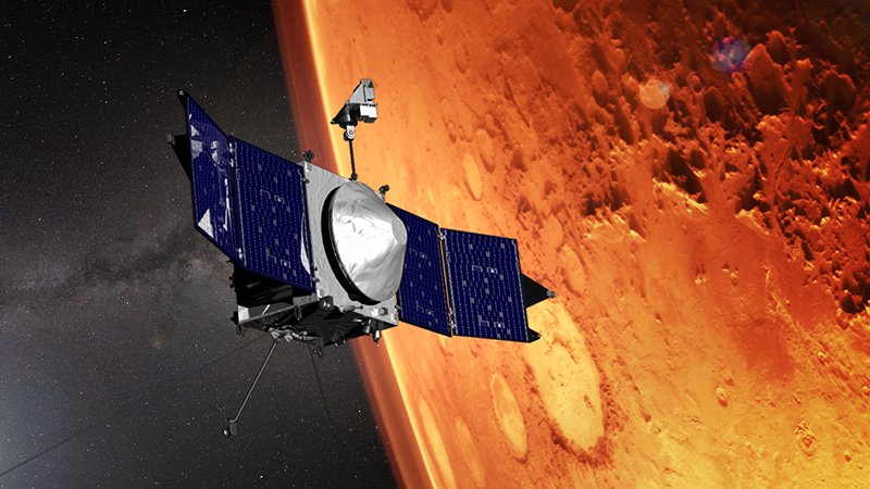 In this artist's conception, the MAVEN spacecraft is orbiting Mars.