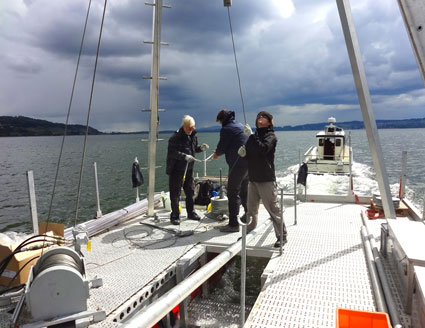 Researchers sail in Switzerland's Lake Murten to core sediments deposited during the Roman Empire.
