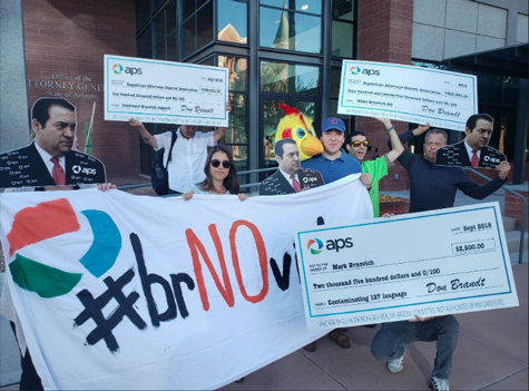 Supporters of an Arizona ballot measure to increase renewable energy standards rally at the state attorney general's office.