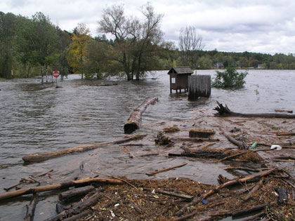 Downed trees and damaged infrastructure from flooding along the Merrimack River in New Hampshire