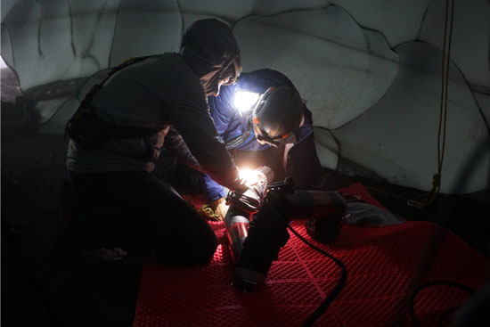 Researchers assemble IceWorm during a test at Mount St. Helens.