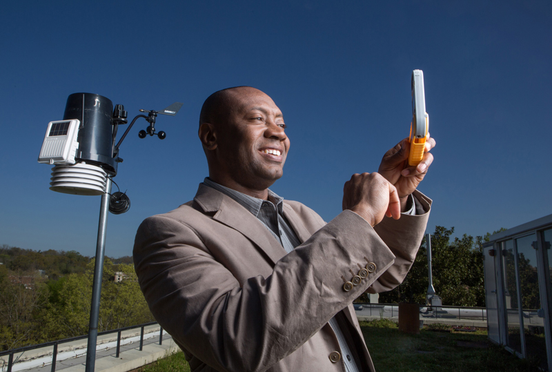 Meteorologist Marshall Shepherd takes wind readings.