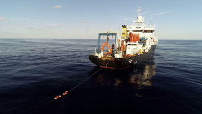 The research vessel towing an observing system mooring
