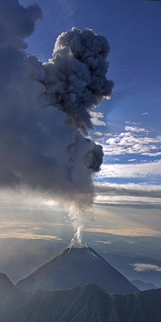 Aerial view of El Reventador volcano, showing the emission column after an explosion on 27 August 2017.