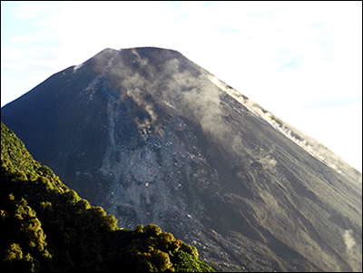 A view of El Reventador from a helicopter overflight around the southeastern flank of the volcano over the jungle.