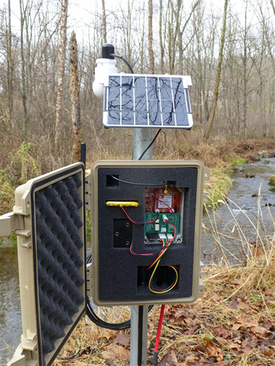 An EnviroDIY Mayfly Data Logger sensor station on the bank of White Clay Creek in Pennsylvania