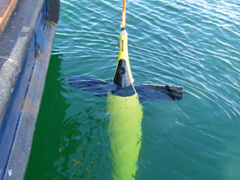 An underwater Seaglider ready for deployment from a research vessel