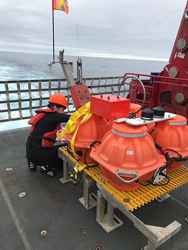 Graduate student Amanda Price inspects a seismometer in preparation for the AACSE deployment off Kodiak.