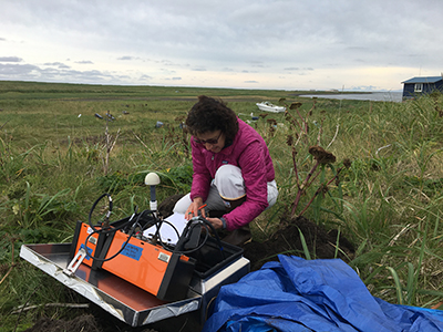 Susan Schwartz services a land-based instrument station on Alaska's Kodiak Island as a part of the AACSE.