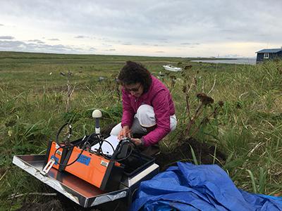 Susan Schwartz services a land-based instrument station on Alaska's Kodiak Island as a part of the AACSE.