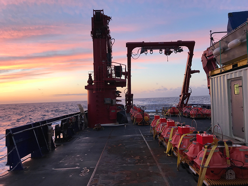 Sunset from the R/V Sikuliaq, July 2018, with broadband ocean-bottom seismometers arranged on deck