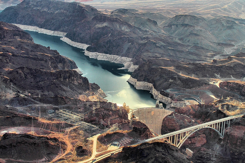 An aerial photo of the Hoover Dam and its reservoir, Lake Mead.