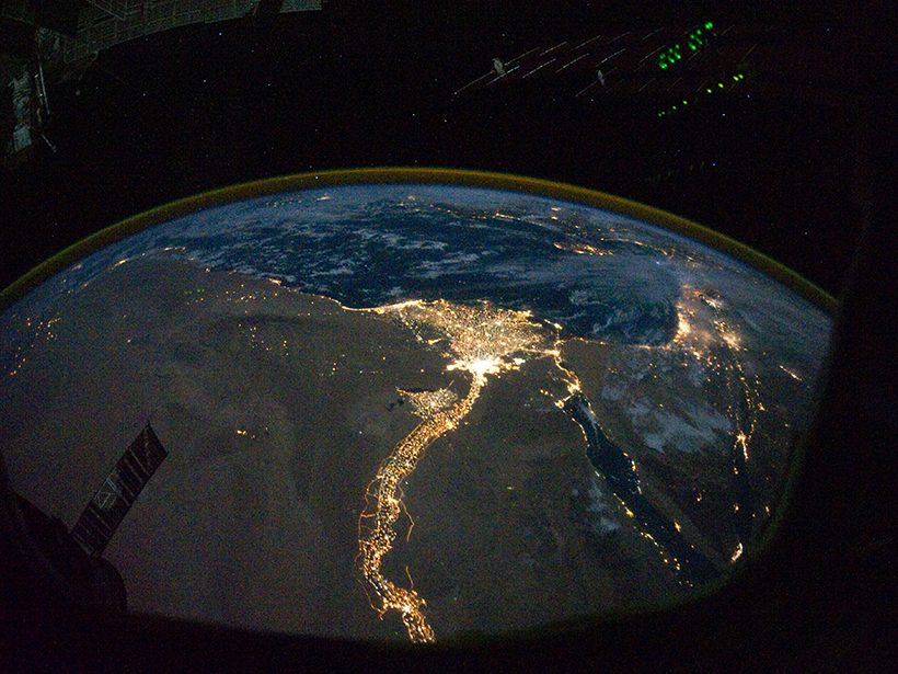 Electric lights illuminate the Nile and its delta in this satellite image captured at night.