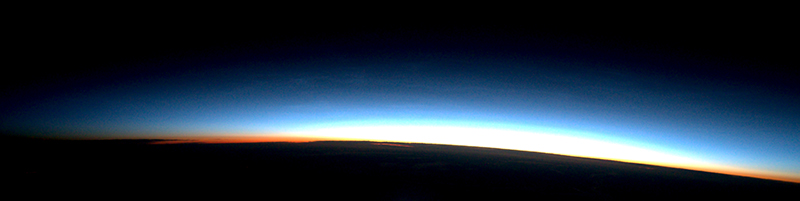 Thin parallel bands of atmospheric gravity waves mark the final stage of evolution of this bank of noctilucent clouds.