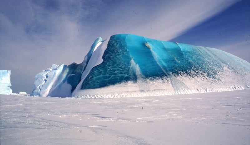 A partly capsized iceberg embedded in sea ice.