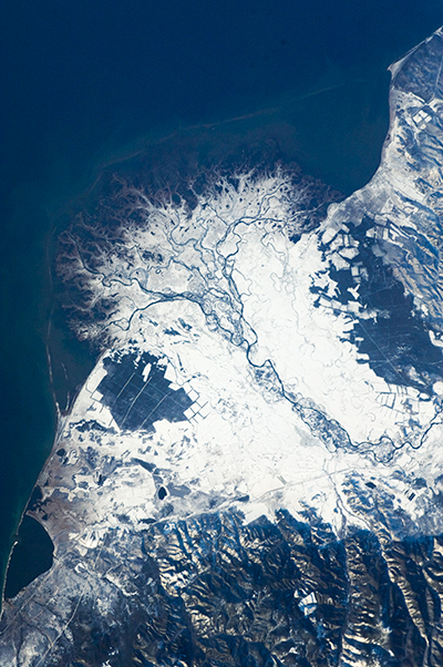 A satellite photo of the frozen delta of the Selenga River.
