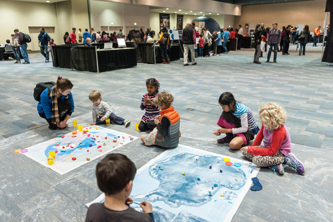 Children of attendees at AGU's Fall Meeting 2015 enjoy activities at Exploration Station.