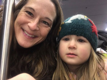 Audrey Taylor, one of the award recipients, with her daughter on her way to AGU's Fall Meeting 2018