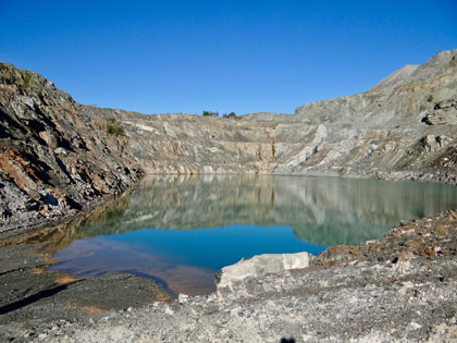 Panoramic view of open pit mine filled with water