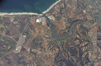 Satellite image of a river emptying into the ocean