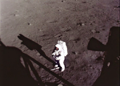 Apollo 11 astronaut Neil Armstrong collecting a contingency sample