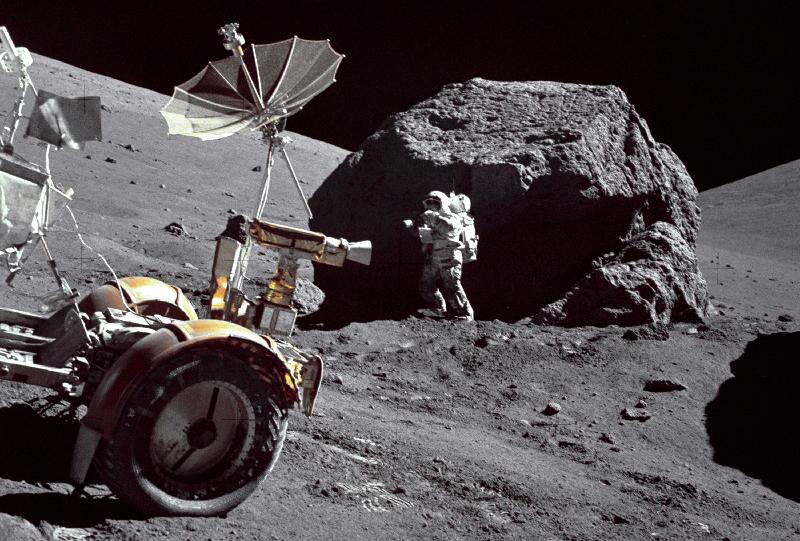 Apollo 17 astronaut Harrison Schmitt collecting a shadowed regolith sample